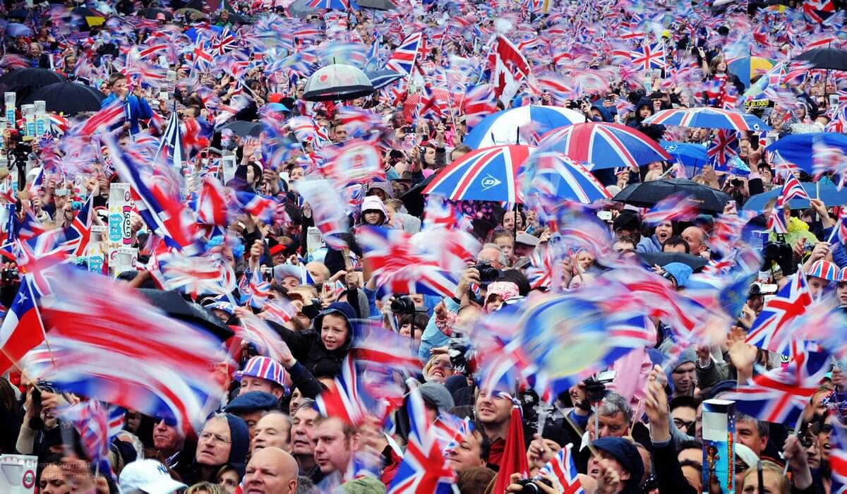 A large crowd at the Queen Victoria Memorial, Buckingham Palace, London during the Queens Diamond Jubilee celebrations in 2012.