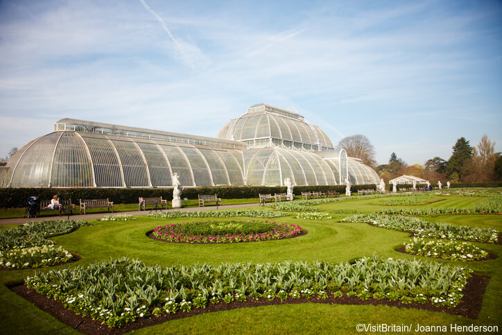 The Royal Botanic Gardens, Kew, usually referred to as Kew Gardens. A national landmark and visitor attraction in West London. The historic Decimum Burton designed glasshouse, the Palm House, with a huge dome, built in the 19th century.